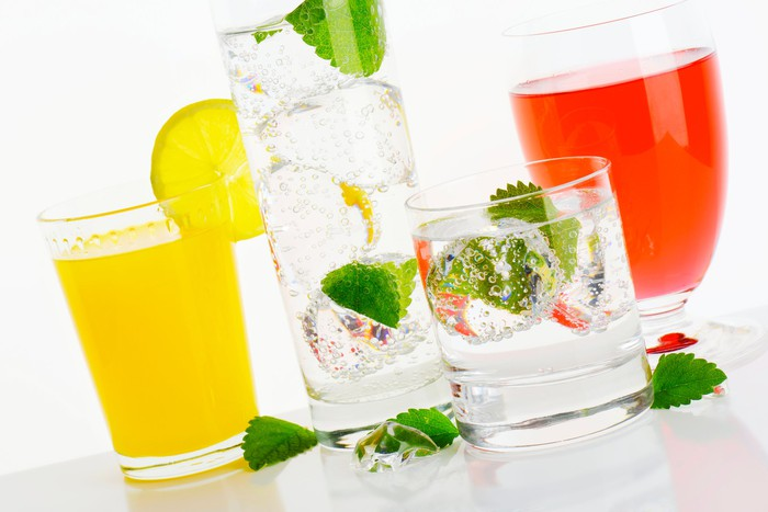 Glasses of hard seltzer with mint and juices