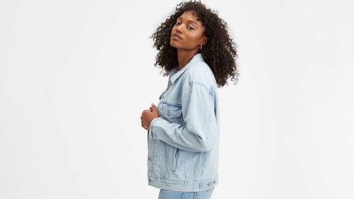 Woman modeling a Levi's jean jacket.
