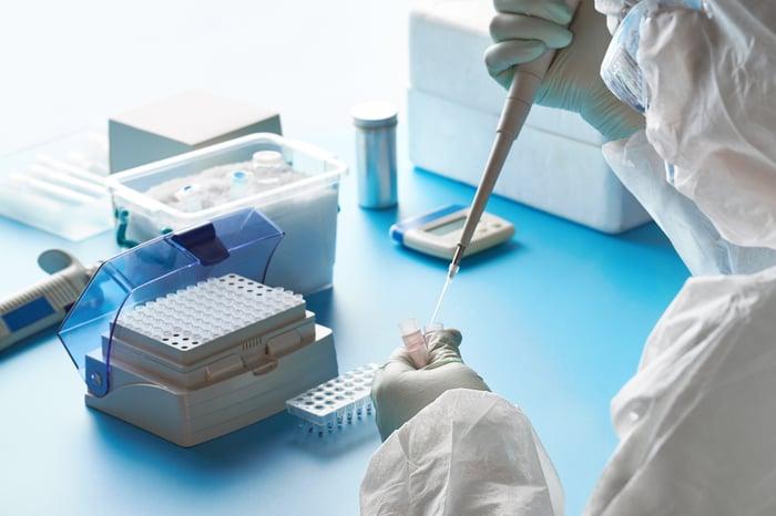 lap worker injecting sample in vial