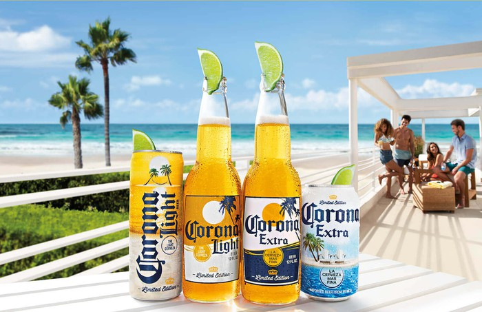 Bottles and cans of Corona beer on table at beach