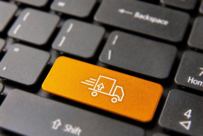 A computer keyboard with a delivery truck pictured on one key.