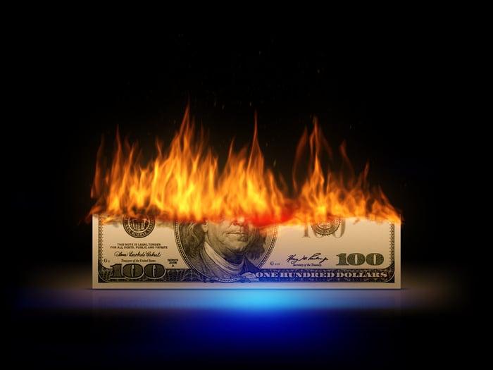 A hundred-dollar bill on fire.