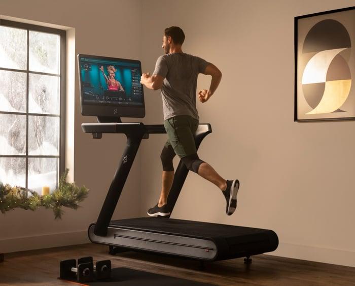 Man running on a Peloton connected treadmill.