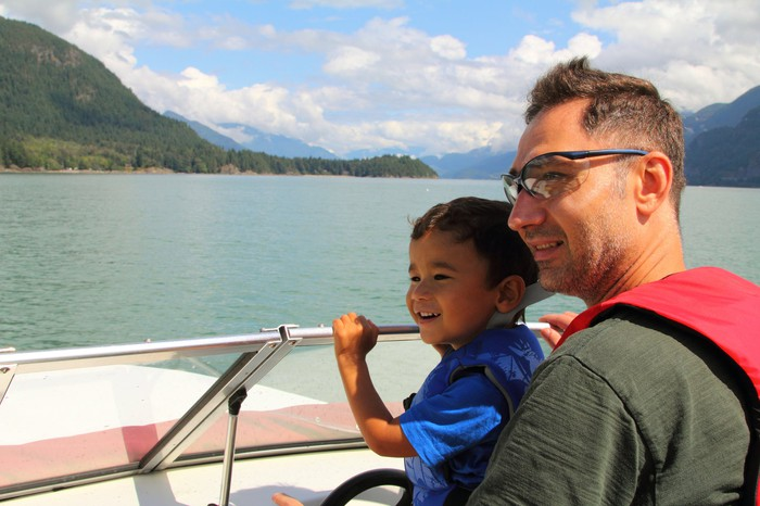 Father and son on a boat.