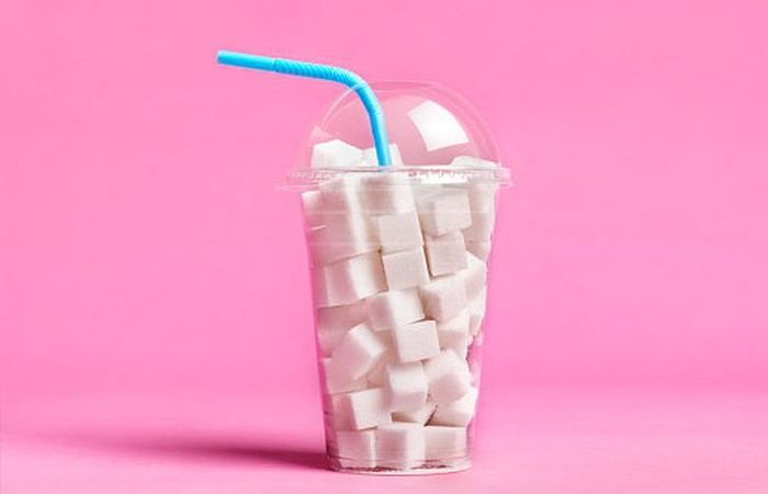 A cup full of sugar cubes