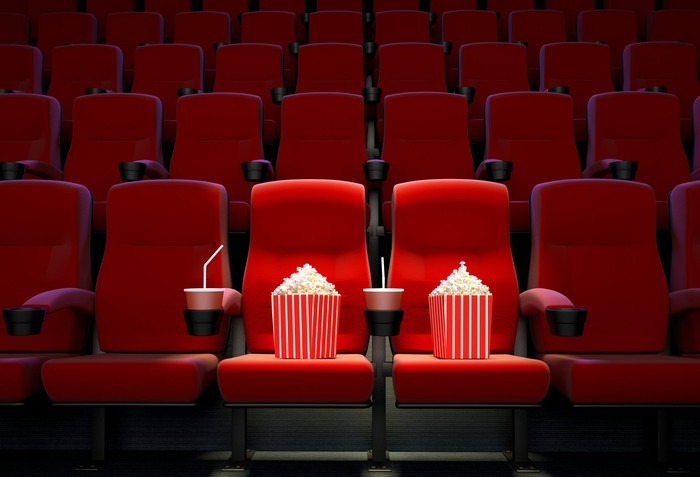 movie theater with empty seats other than bags of popcorn in two front seats