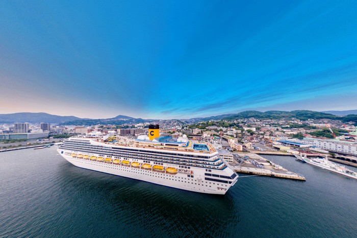 An aerial view of Carnival's Costa Fortuna on the water