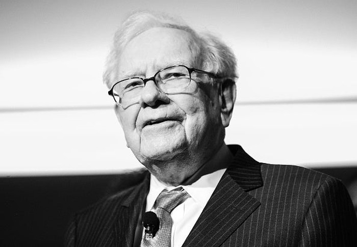 a black and white photograph of Warren Buffett