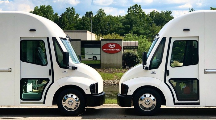 wo Workhorse C-Series vans in front of the company's Ohio headquarters.