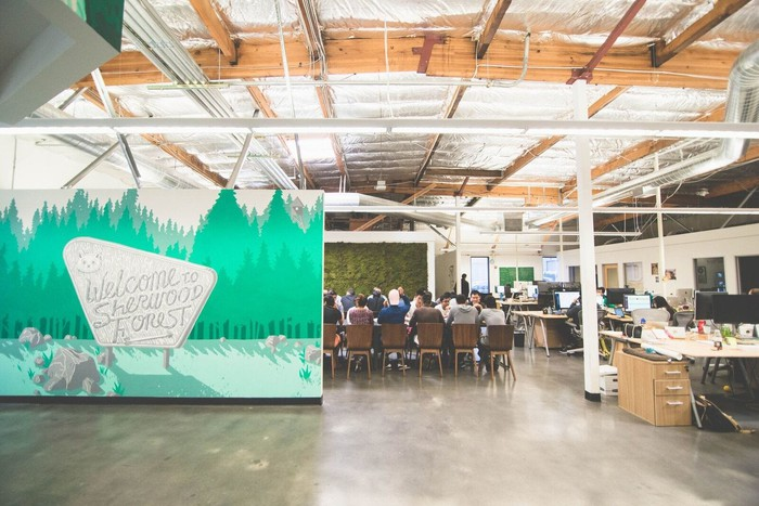 Robinhood headquarters with people seated around a conference table in the background.