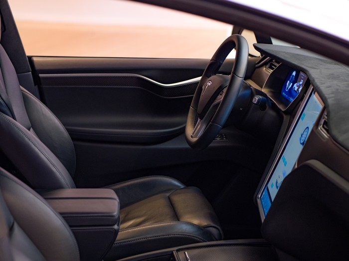 Tesla Model S interior seen from the front passenger side.