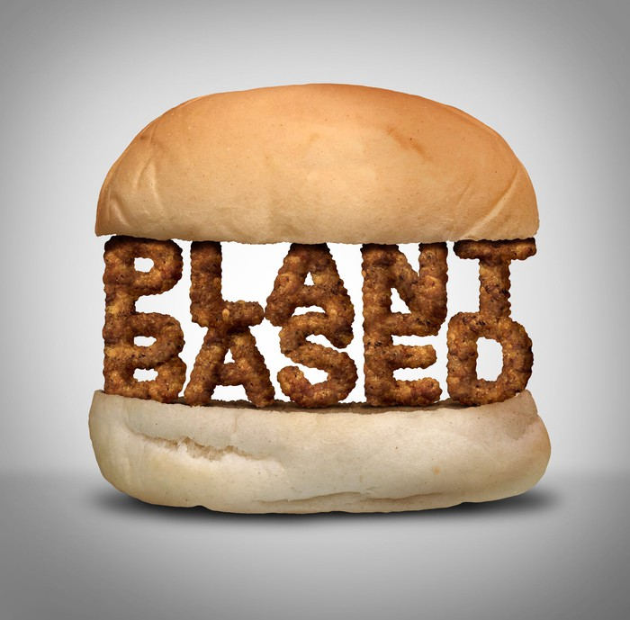 """A bun with the words """"PLANT BASED"""" sandwiched in between the two slices."""