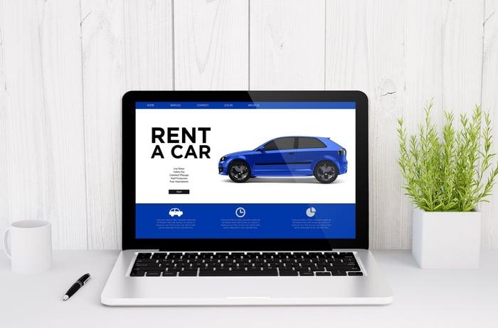 Laptop with car rental website open
