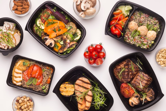 Six meals in plastic takeout containers