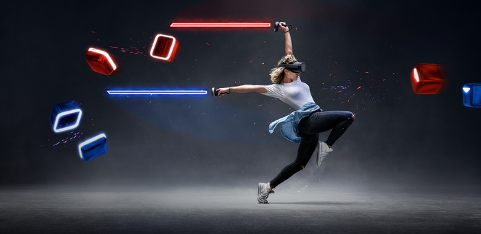 A woman plays Beat Saber on the Oculus Quest.