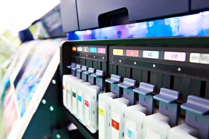 Color ink cartridges in a printer.