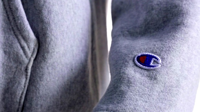 A sweatshirt with the Champion logo on the sleeve.