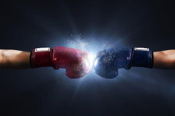 Boxing gloves clashing.