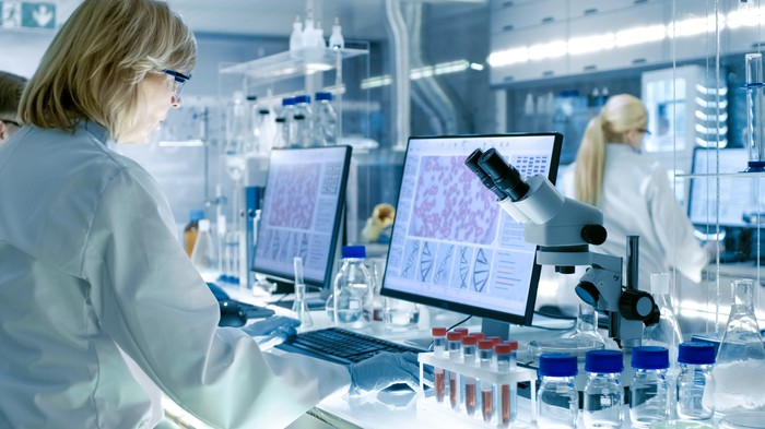 Two female scientists edit a gene sequence in a laboratory.