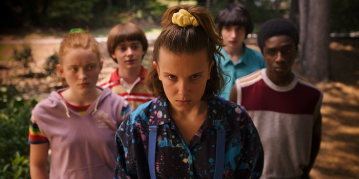A teen girl, flanked by four friends, looking intently at an unseen foe in Stranger Things from Netflix.