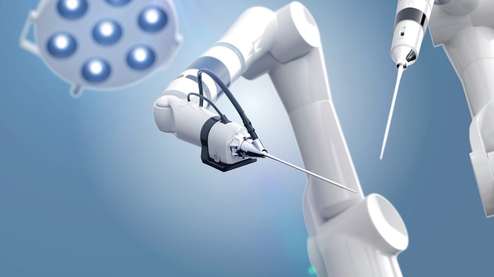Medical robot arms viewed from an operating table's angle