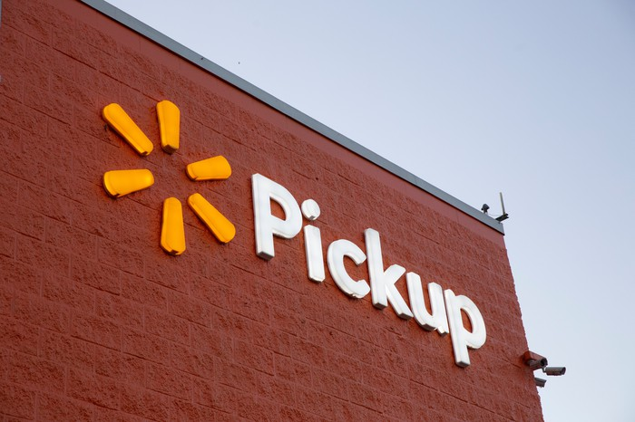 """Walmart """"Pickup"""" sign at the corner of a Walmart store building."""