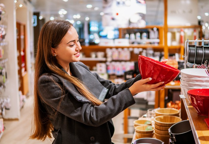 Woman looking at a bowl to buy.