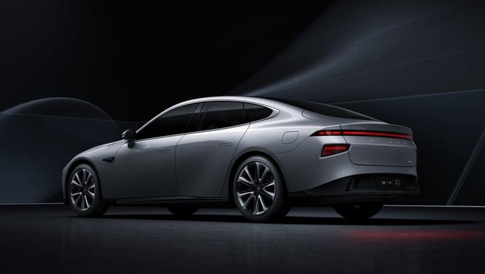 A silver Xpeng P7, a sleek electric luxury-sports sedan.