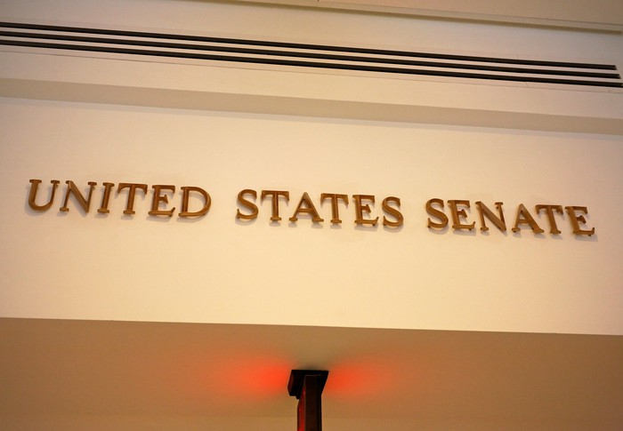The words United States Senate written in gold