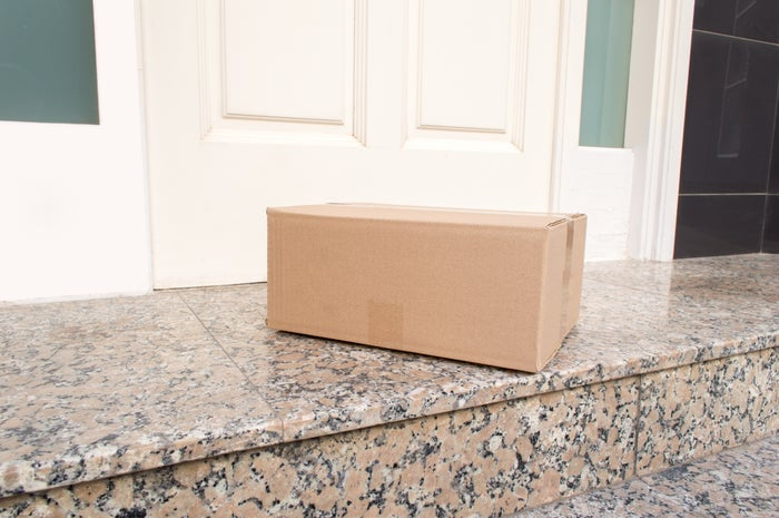 A box sitting on a front porch.