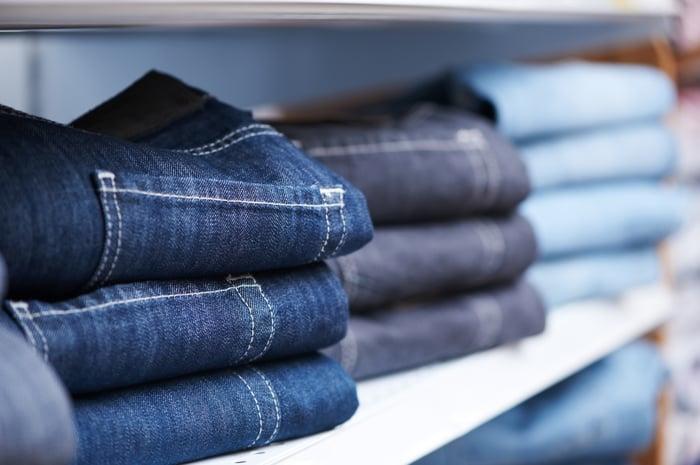 Jeans sitting on a shelf.