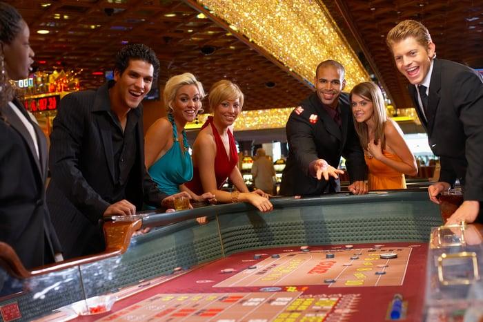 People gambling at a casino.