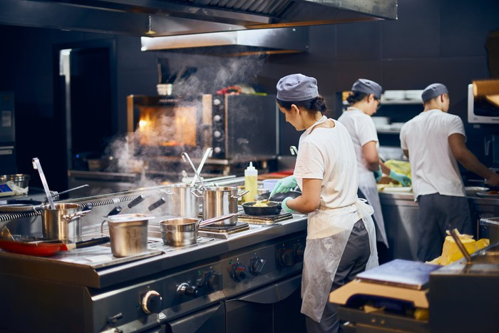 A restaurant kitchen in operation.