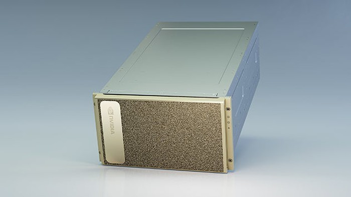 The DGX A100, a simple silver box with NVIDIA logo on the front.