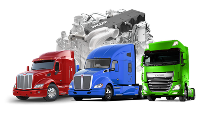 Three trucks in red, blue, and green, next to PACCAR engine.