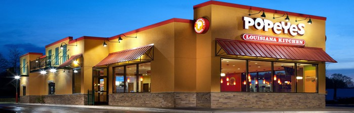 The exterior of a Popeyes restaurant