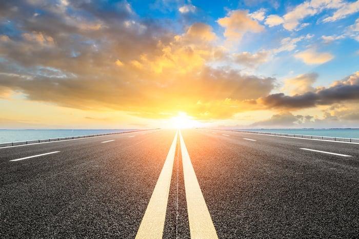 View down a roadway into a bright horizon.