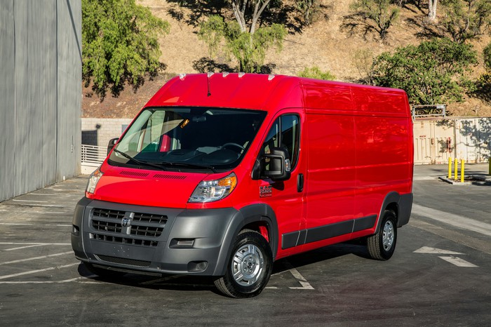 A red Ram ProMaster commercial van.
