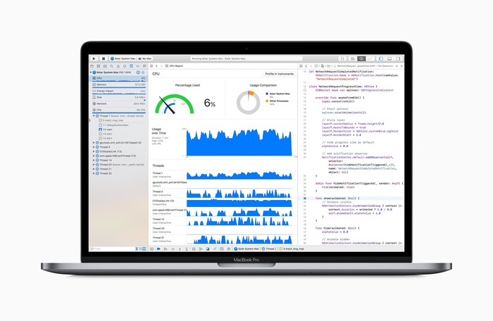 MacBook Pro laptop displaying code and graphs