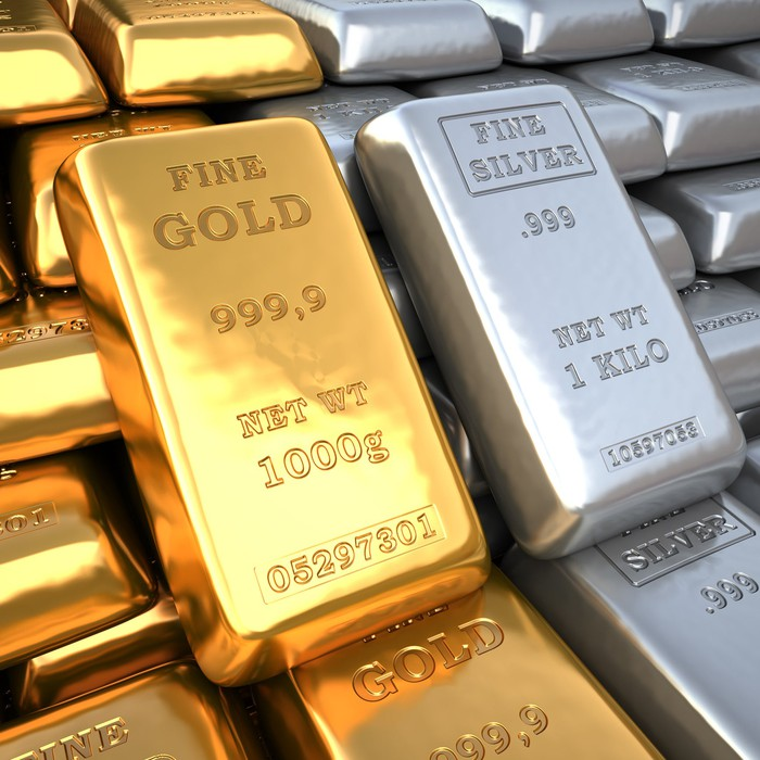 Gold and silver bars sitting next to each other.