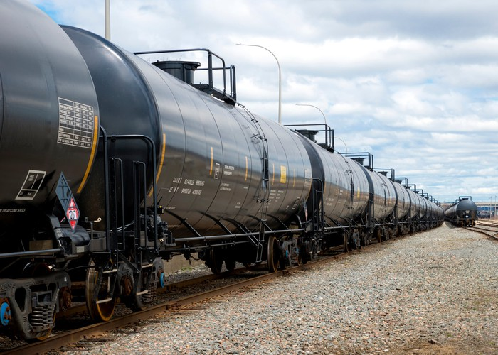 Tanker cars lined up on a rail line