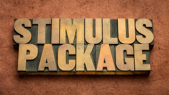The words stimulus package in gold block letters