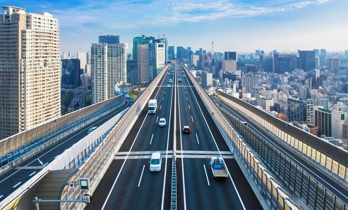 Road running through city
