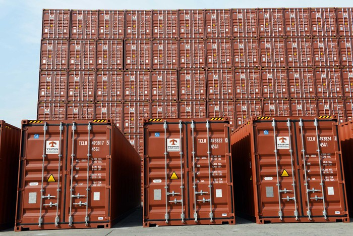 Triton containers stacked at a port.