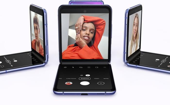 Three Samsung Z Flip phones displayed in purple.