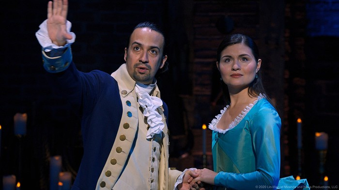A still of the Broadway recording of Hamilton, with characters Hamilton and Eliza looking out into the distance.