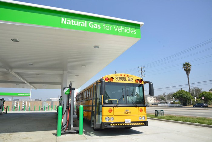school bus filling up at a natural gas fueling station