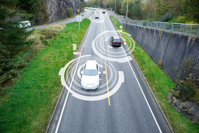 cars driving with a communications field around them