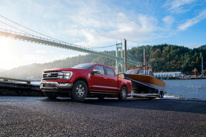 A 2021 Ford F-150 pulling a boat on a trailer.