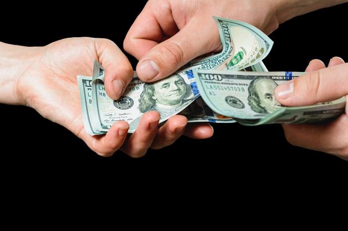 Handing over cash.
